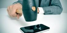businessman broking a smartphone