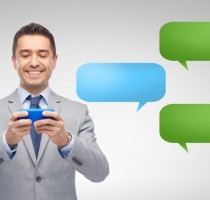 happy businessman texting message on smartphone