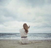 beautiful alone girl on the beach