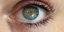Eye with copyright sign in the pupil concept