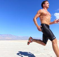 Athlete running sport - fitness runner in desert