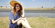 Beautiful redhead girl at countryside nead lake.