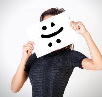 Young woman facing bipolar disorder - happy & sad