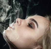 blond girl smoking
