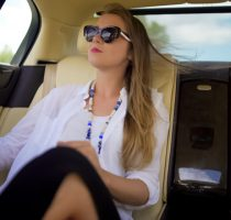 Beautiful independent woman enjoying car trip on vacation, business traveler
